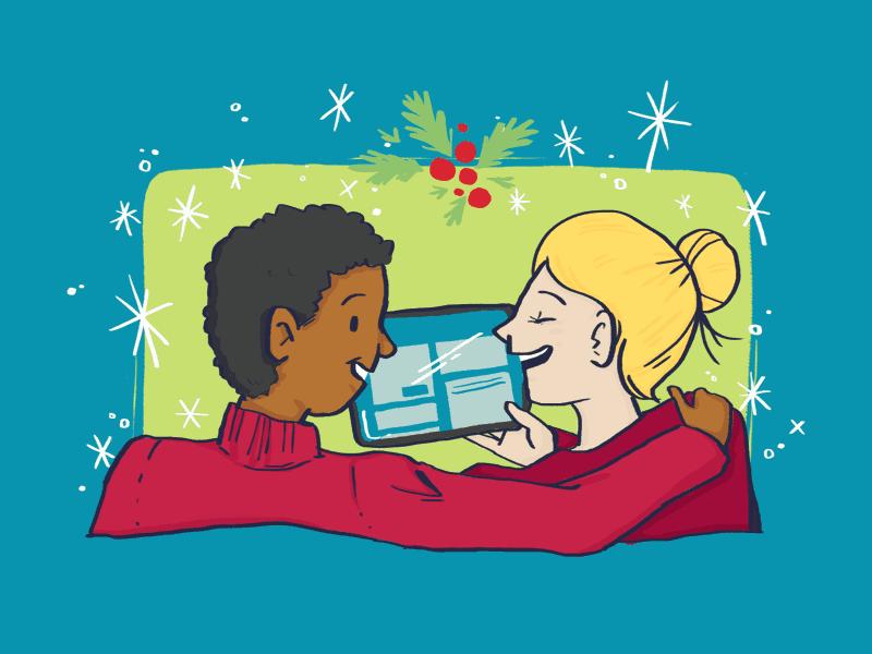 Deux personnes devant une tablette avec des decorations des fetes.