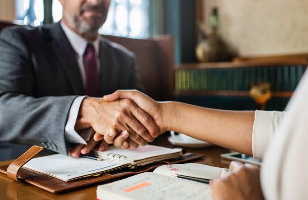 Handshake, closing deal.