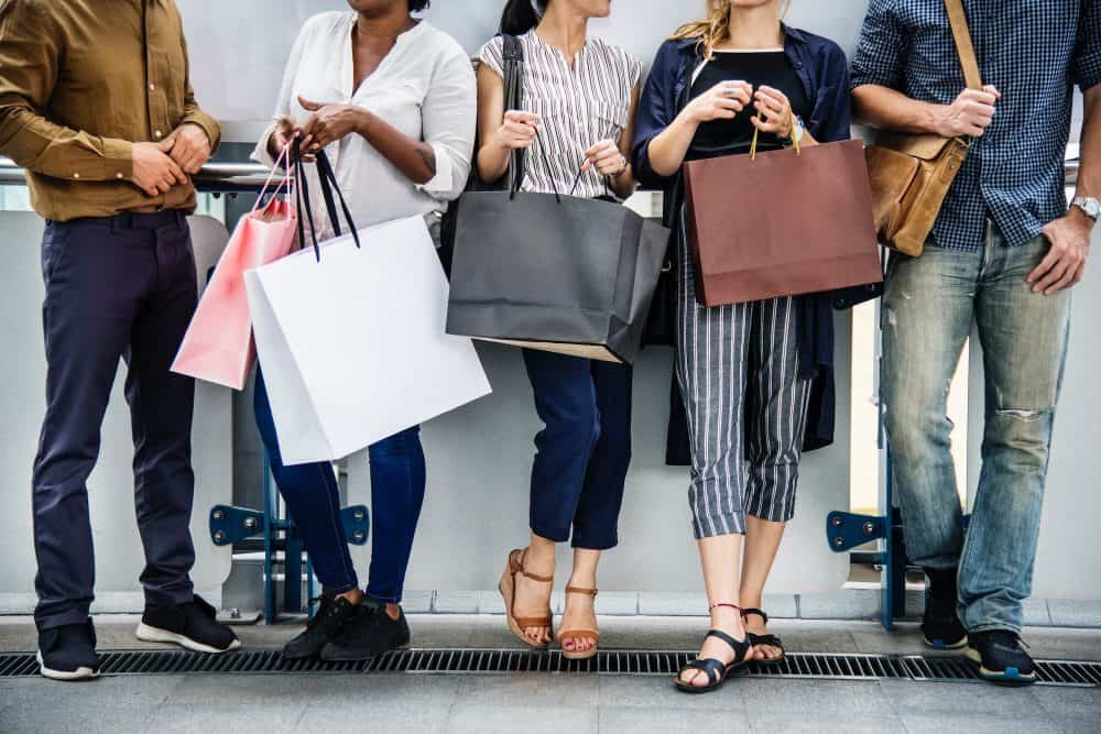 People with shopping bags - Photo by rawpixel.com from Pexels