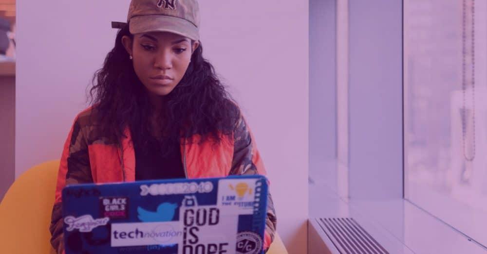 woman coding on a laptop